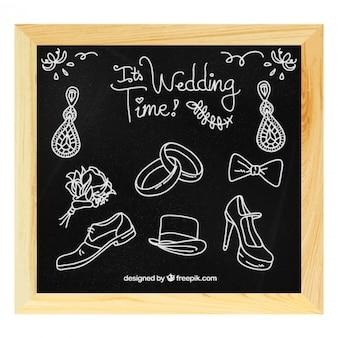 Accesorios de boda dibujados a mano en pizarra