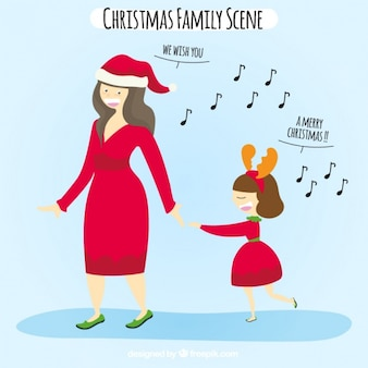 Adorable escena de madre e hija cantando villancicos
