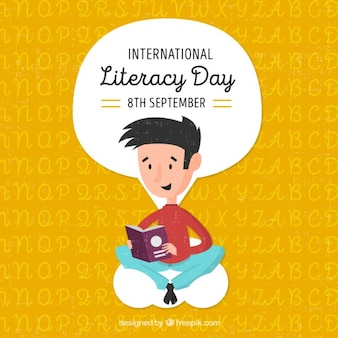 Adorable fondo del día de la alfabetización con chico leyendo un libro