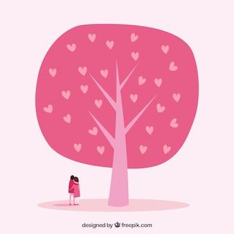 Adorable pareja con árbol rosa de corazones