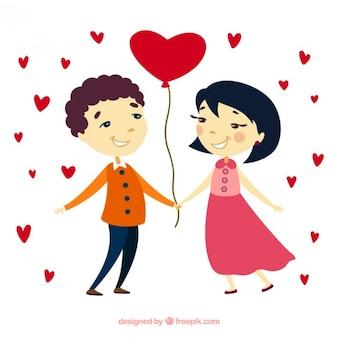 Adorable pareja con un globo en forma de corazón