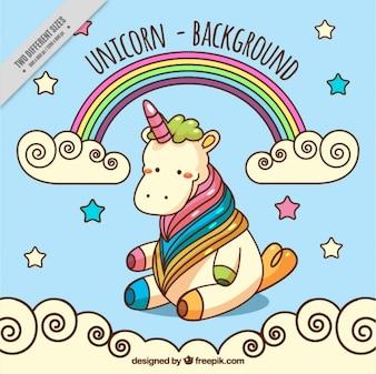 Adorable unicornio dibujado a mano con un arcoiris