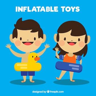 Adorables niños con flotadores