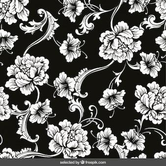 Adornos florales sobre fondo negro