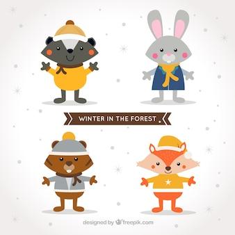 Animales del bosque sonrientes con ropa de invierno