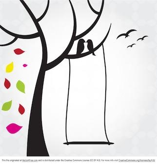 árbol con las hojas que caen y aves
