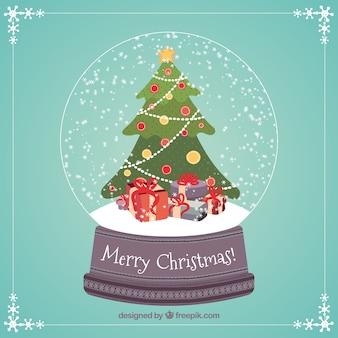Árbol de navidad y regalos dentro de una bola de nieve