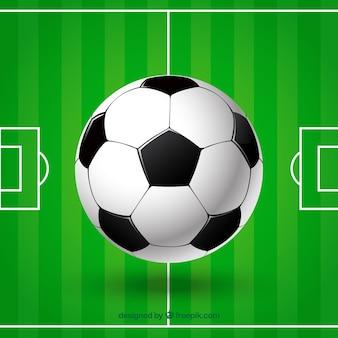 Balón y campo de fútbol