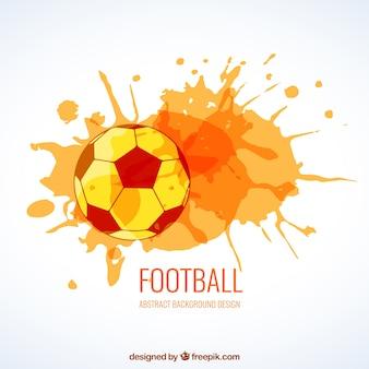 Balón de fútbol con salpicaduras de acuarela