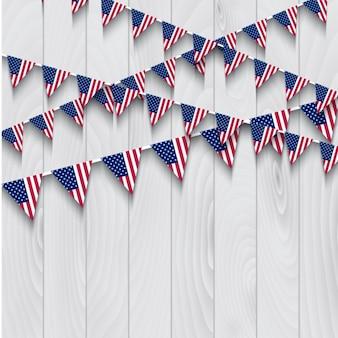 Banderas de Estados Unidos sobre fondo de madera