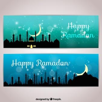 Banners brillantes de ramadan con siluetas de ciudad
