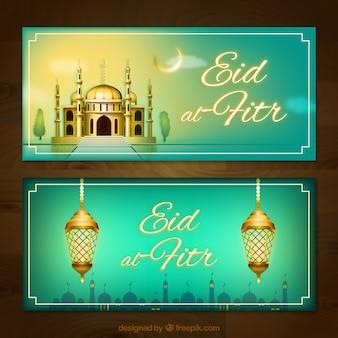 Banners de eid al fitr con mezquita y lámparas