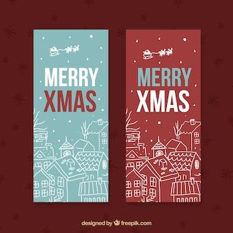 Banners de feliz navidad con bocetos de casas