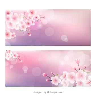 Banners de flores del cerezo con efecto bokeh