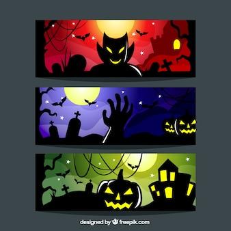 Banners de halloween espeluznantes con elementos iluminados