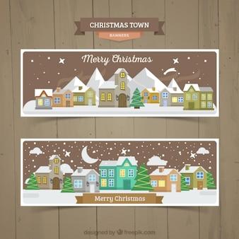 Banners de navidad de ciudad nocturna nevada