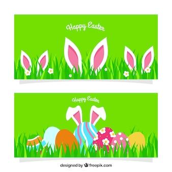 Banners de pascua plano con orejas de conejo y huevos