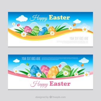 Banners de pascua realistas con huevos decorativos