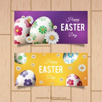 Banners de pascua realistas con huevos y margaritas