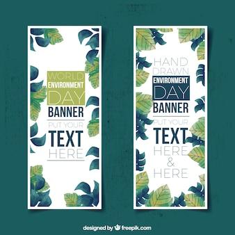 Banners del día mundial del medioambiete con hojas dibujadas a mano