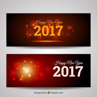 Banners elegantes de año nuevo con formas brillantes