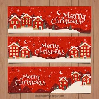 Banners rojos de pueblo navideño en estilo vintage