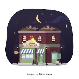 Bonita escena nocturna de fachada de restaurante