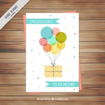 Bonita tarjeta de cumpleaños con globos y regalo