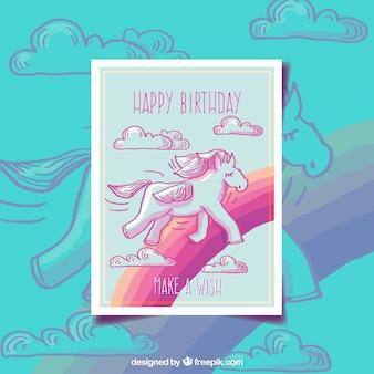 Bonita tarjeta de cumpleaños de unicornio y arcoiris