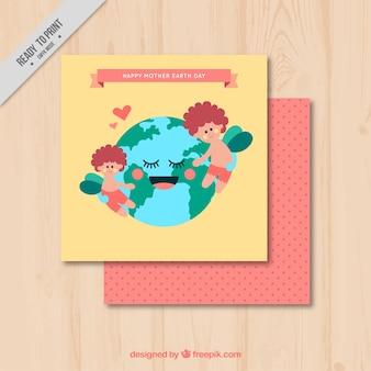 Bonita tarjeta de felicitación con el planeta tierra abrazando niños