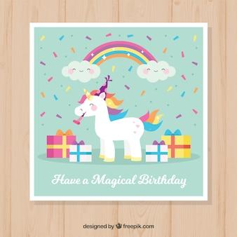Bonita tarjeta de unicornio con regalos