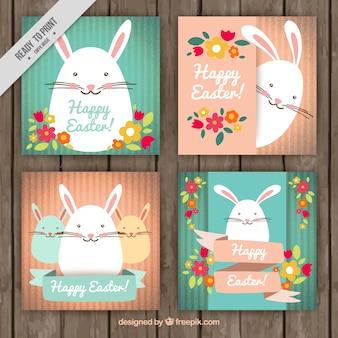 Bonitas tarjetas del día de pascua con conejitos y flores