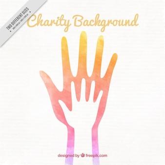 Bonito fondo de acuarela de organización benéfica con manos