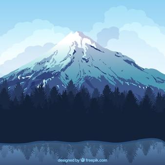 Bonito fondo de paisaje de invierno con montaña nevada