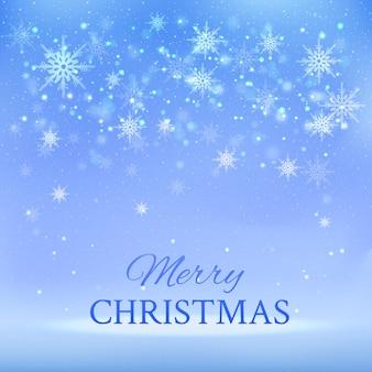 Bonito fondo navideño azul con copos de nieve