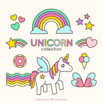 Bonito unicornio con adorables accesorios dibujados a mano