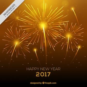 Brillante fondo amarillo con fuegos artificiales para año nuevo