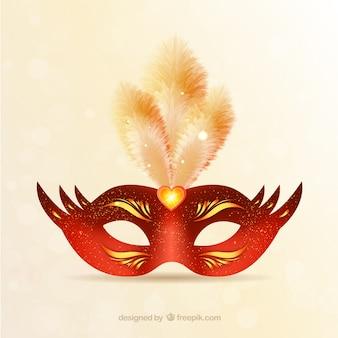 Brillante mascara de carnaval en tonos rojos y dorados