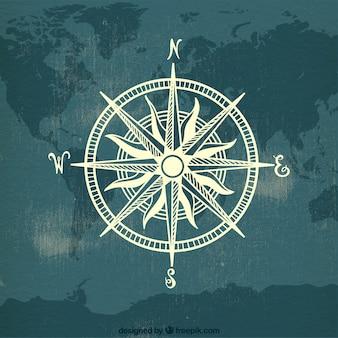 Brújula sobre fondo de mapa del mundo