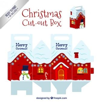 Caja de casa navideña nevada