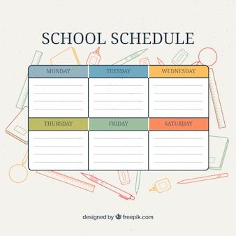 Calendario con artículos escolares de fondo