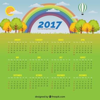 Calendario con un paisaje y un arco iris