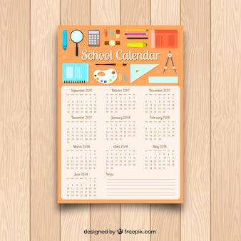 Calendario escolar con materiales en diseño plano