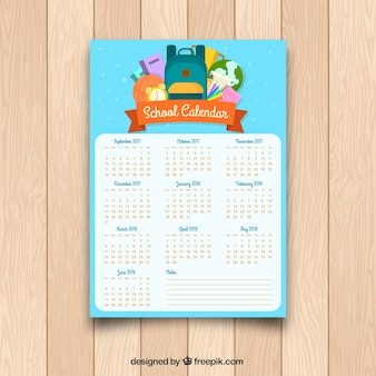Calendario escolar con mochila y otros elementos en diseño plano