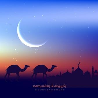 Camellos caminando en la noche con la mezquita