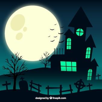 Casa escalofriante y la luna grande