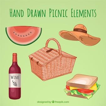 Cesta con elementos de picnic dibujados a mano