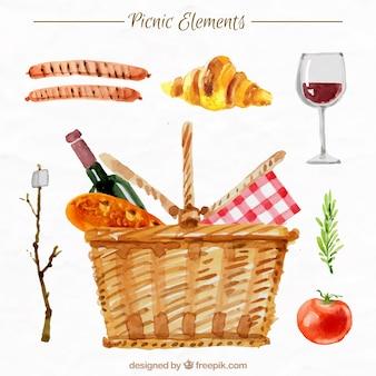 Cesta con elementos de picnic en efecto acuarela