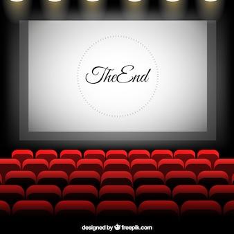 Cine con pantalla y asientos rojos