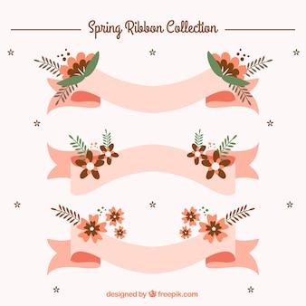 Cintas rosas con flores de primavera en diseño plano